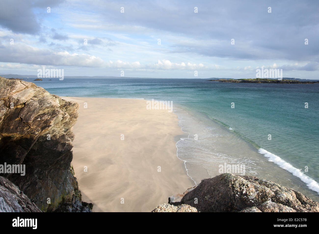 A deserted Irish beach on the Island of Inishbofin, in the West of Ireland with waves breaking on the golden sandy Stock Photo