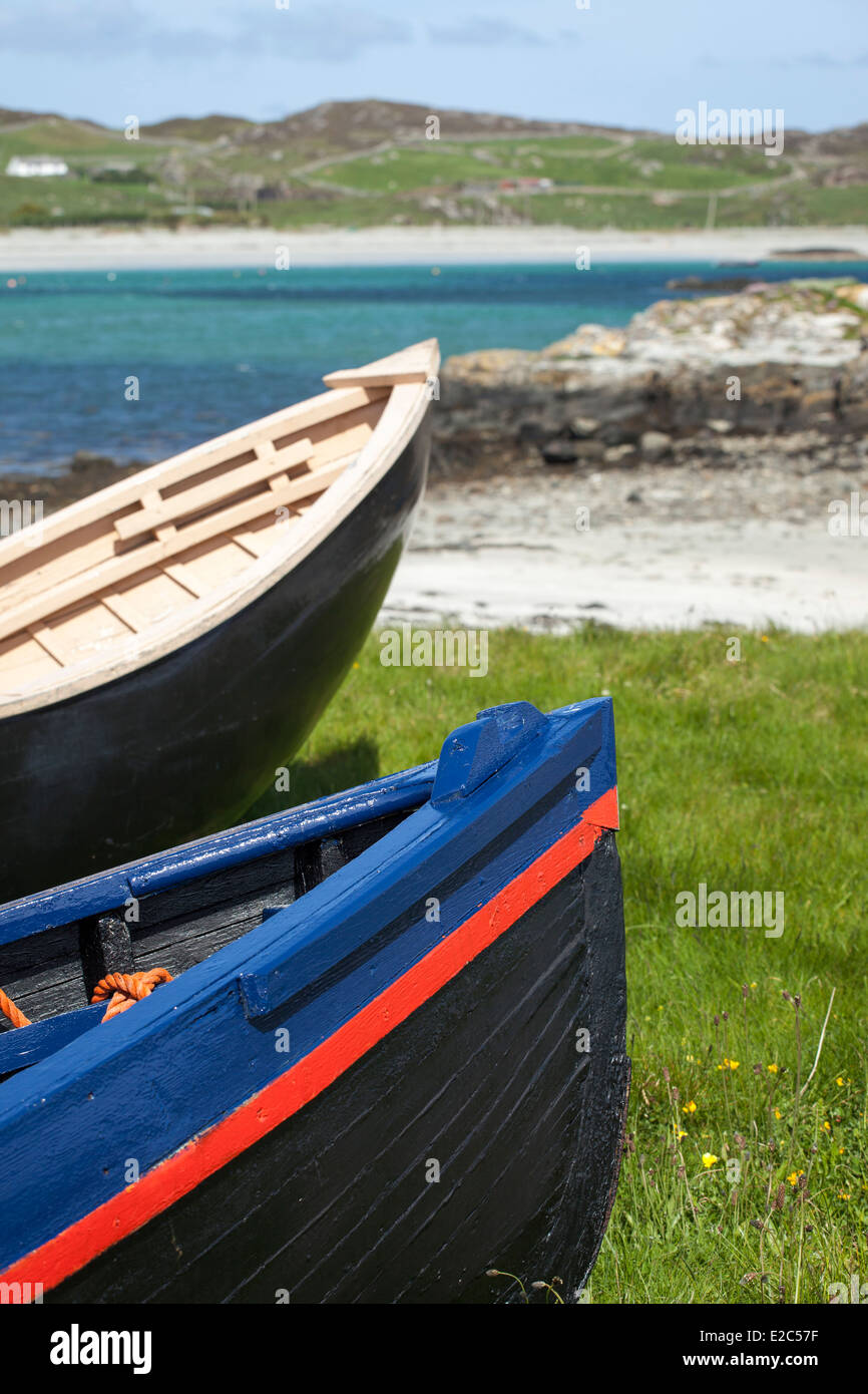 Two Colourful Irish Currachs, West of Ireland on a bright sunny day - Stock Image