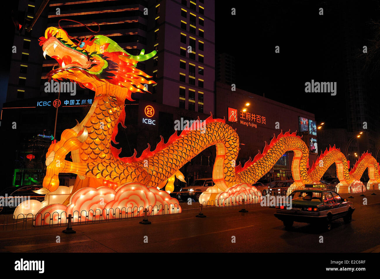 China, Qinghai, Xining, Chinese New Year festival, Illuminated dragon - Stock Image