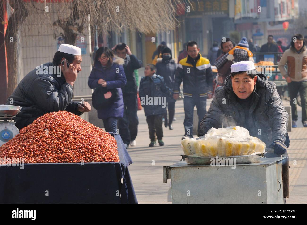 China, Qinghai, Xining, Hui Muslim street vendors - Stock Image