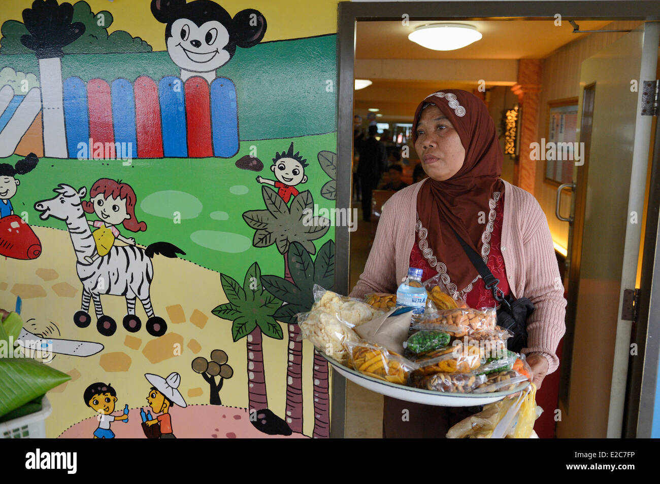 Indonesia, Lombok, saleswoman on the ferry to Sumbawa - Stock Image