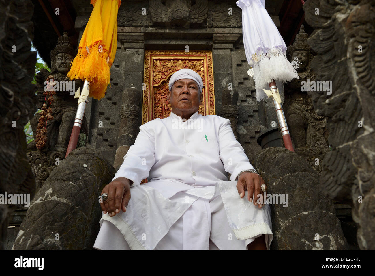 Indonesia, Bali, Padangbai, priest at Pura Tanjungsari temple - Stock Image