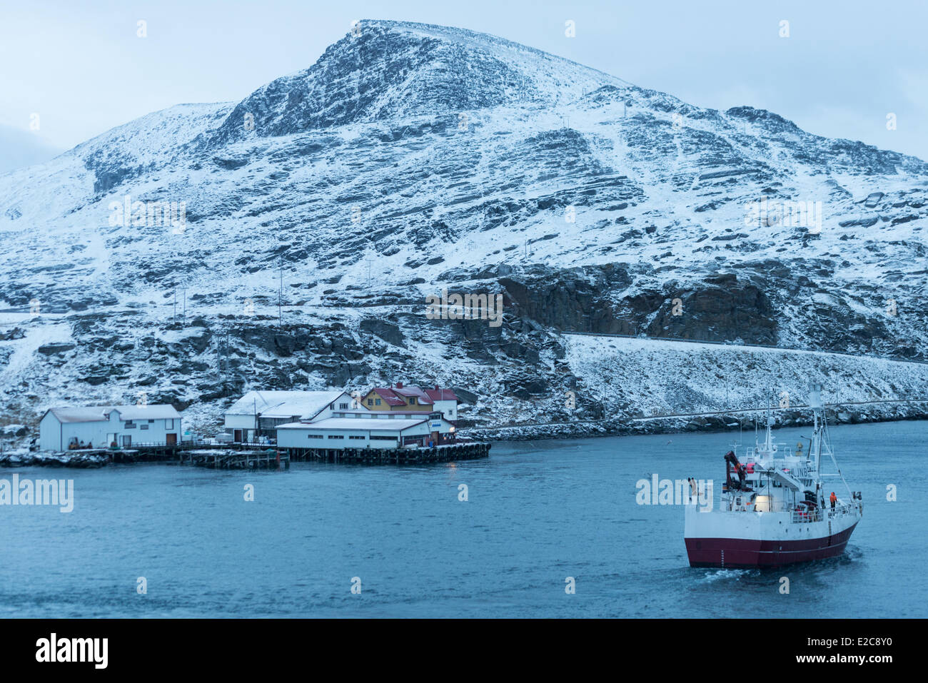 Norway, Finnmark, Havoysund, fisher boat arriving in the harbour - Stock Image