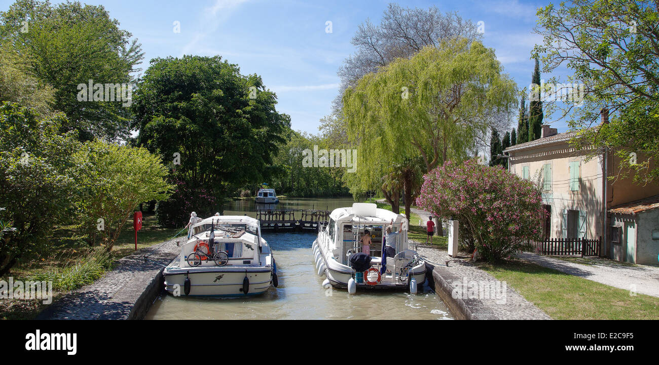 France, Aude, Castelnaudary, navigation on the Canal du Midi, listed as World Heritage by UNESCO, the lock Saint - Stock Image