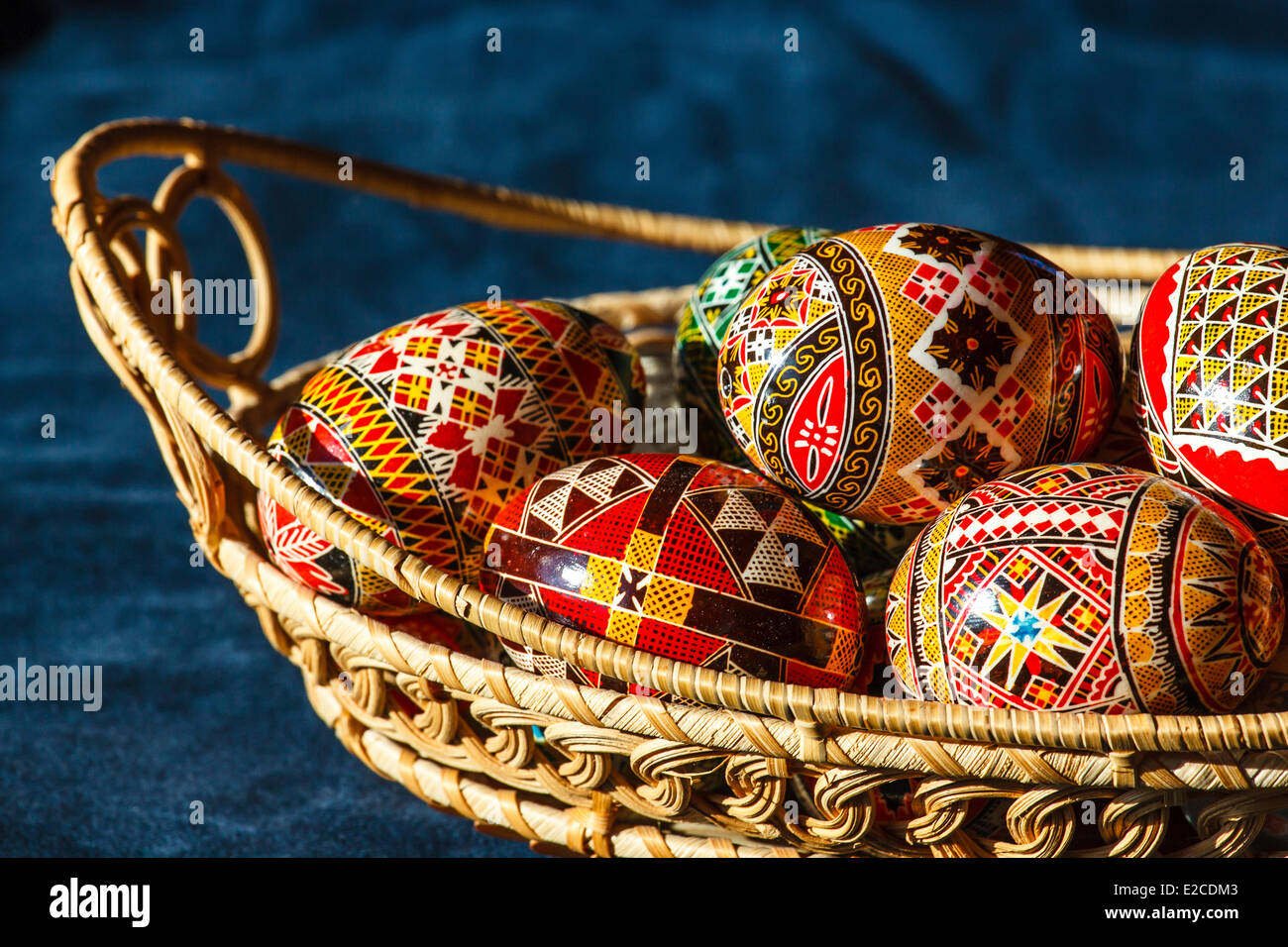 Romania, Bukovina Region, Moldovita, painted Easter eggs in a wicker basket - Stock Image