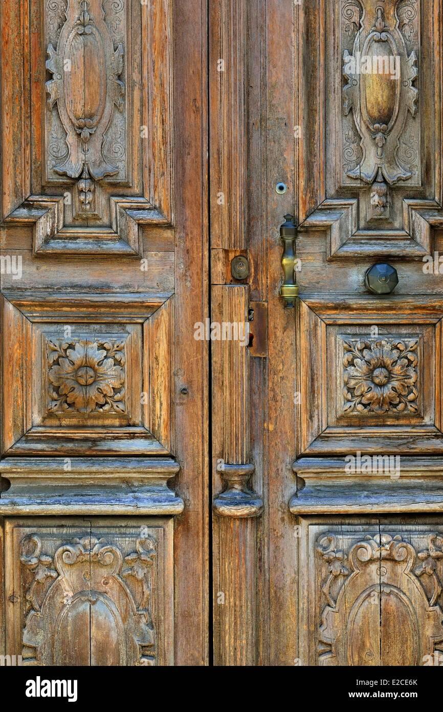 France, Herault, Serignan, detail of wooden sculptured door - Stock Image