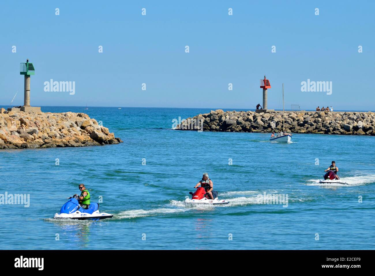 France, Herault, Valras Plage, Jets ski in the mouth of the marina behind the pier - Stock Image