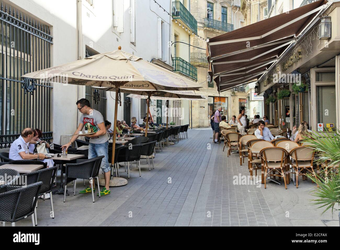 France, Herault, Beziers, Shell Street, the passers by in front of Cafe terraces - Stock Image