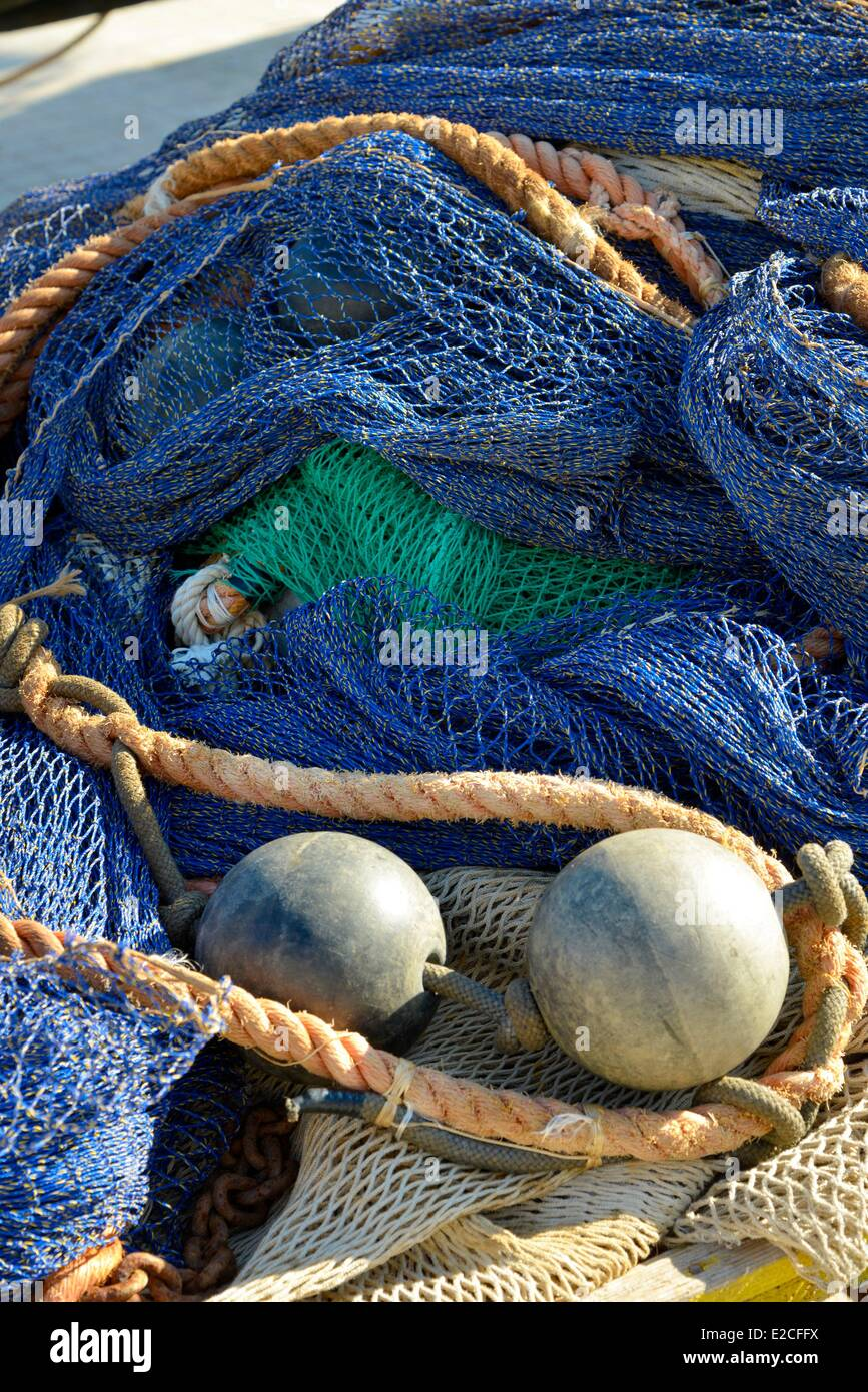 Italy, Sicily, Trapani, historic center, fishing port, fishing nets in the midst of blue floats and ropes - Stock Image