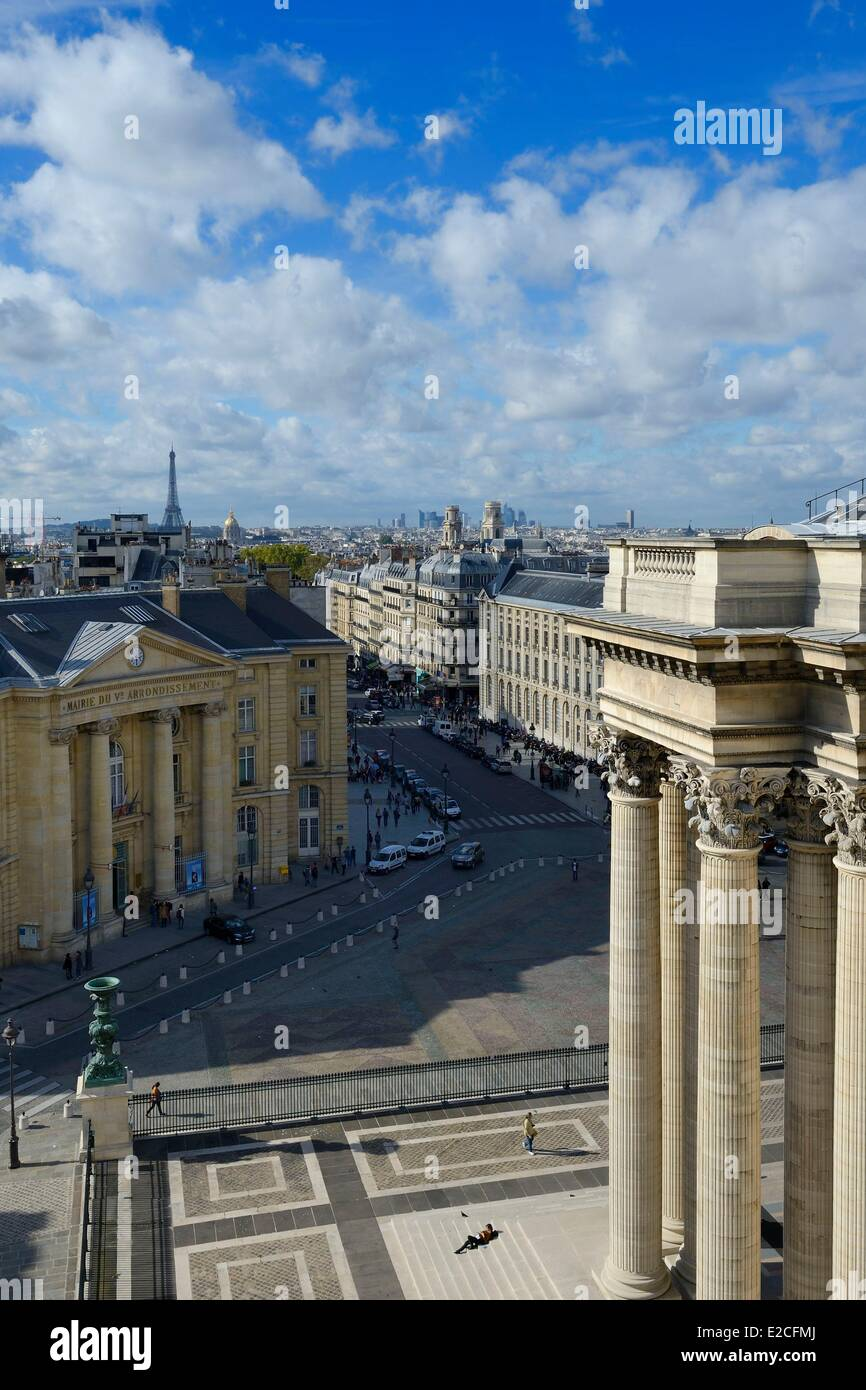 France, Paris, Corinthian columns of pediment of Pantheon, town hall of fifth district and Eiffel Tower in background - Stock Image