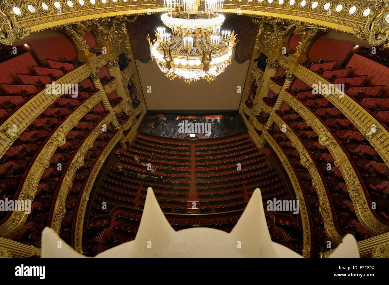 France, Paris, Garnier Opera, the auditorium overlooked by the 7 to 8 ton bronze and crystal chandelier designed - Stock Image