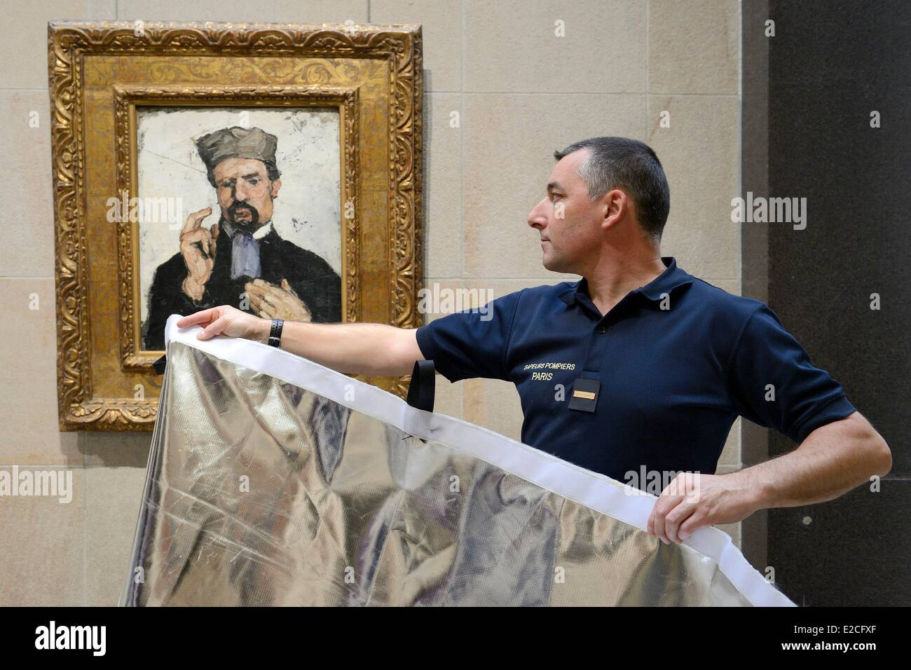 France, Paris, the Orsay Museum, the fireman Chief Warrant Officer Xavier Tremeau using a cover designed specifically - Stock Image