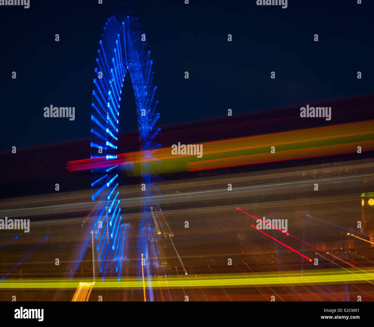 Central London Westminster London Eye , Millennium Wheel , bus lights , at night with zoom blur abstract art artistic - Stock Image