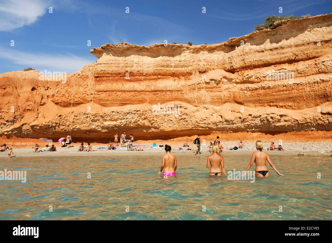 Spain Balearic islands Ibiza Sa Caleta beach and red cliffs listed as World Heritage by UNESCO - Stock Image