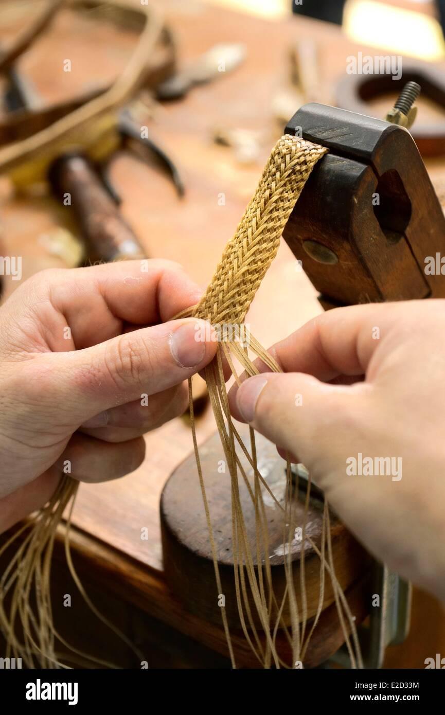 Argentina Buenos Aires Province San Antonio de Areco Alejandro Alvarez plait leather parts of horses harness in - Stock Image