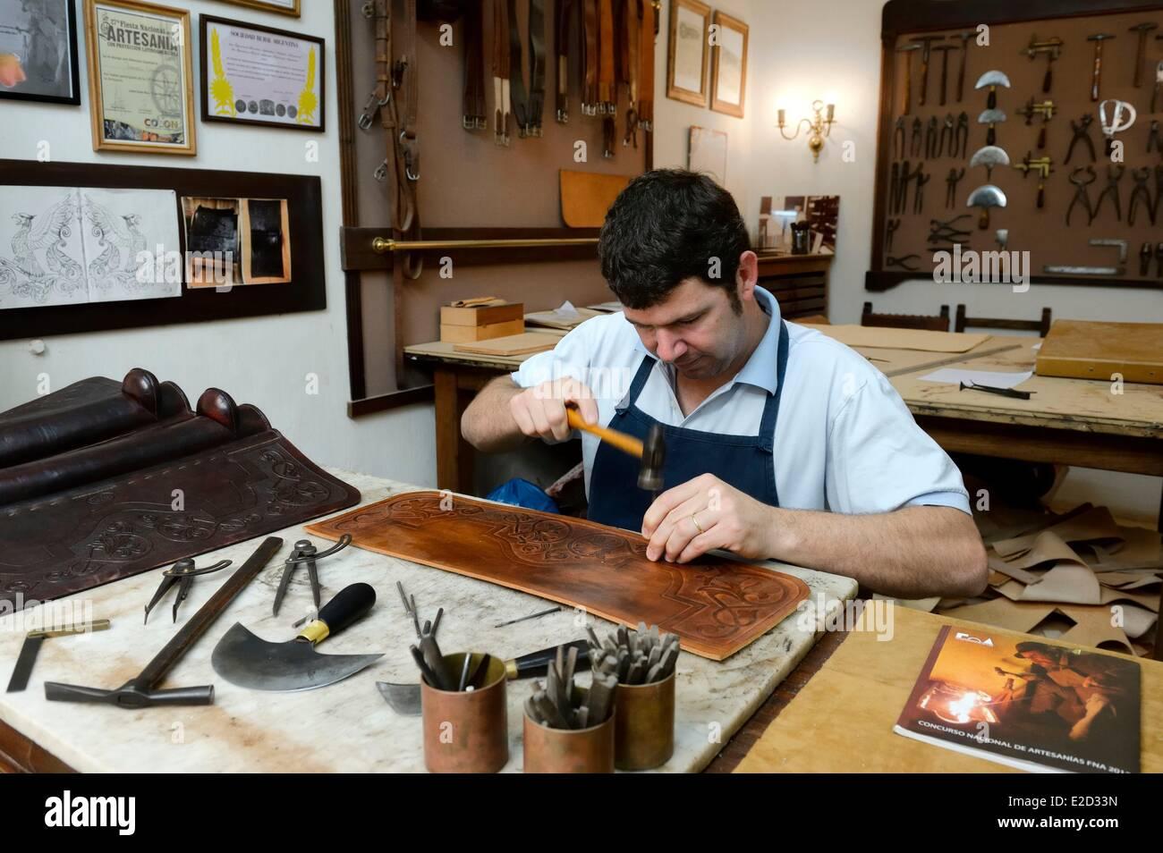 Argentina Buenos Aires Province San Antonio de Areco workshop of the leather craftsman Martin Alvarez hammering - Stock Image