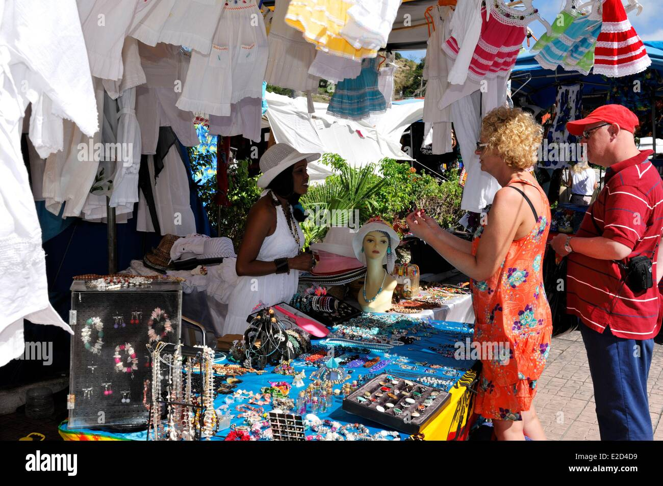 France Guadeloupe Saint Martin Marigot market couple stopped at a stand of jewelry and clothing - Stock Image