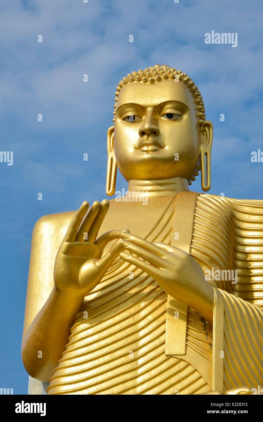 Sri Lanka Central Province Matale District Dambulla Statue of huge Buddha covered with gold leaves - Stock Image