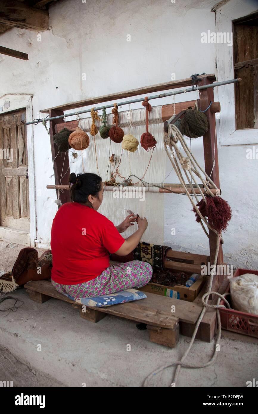 Turkey, Mugla region, weaving carpet workshop - Stock Image