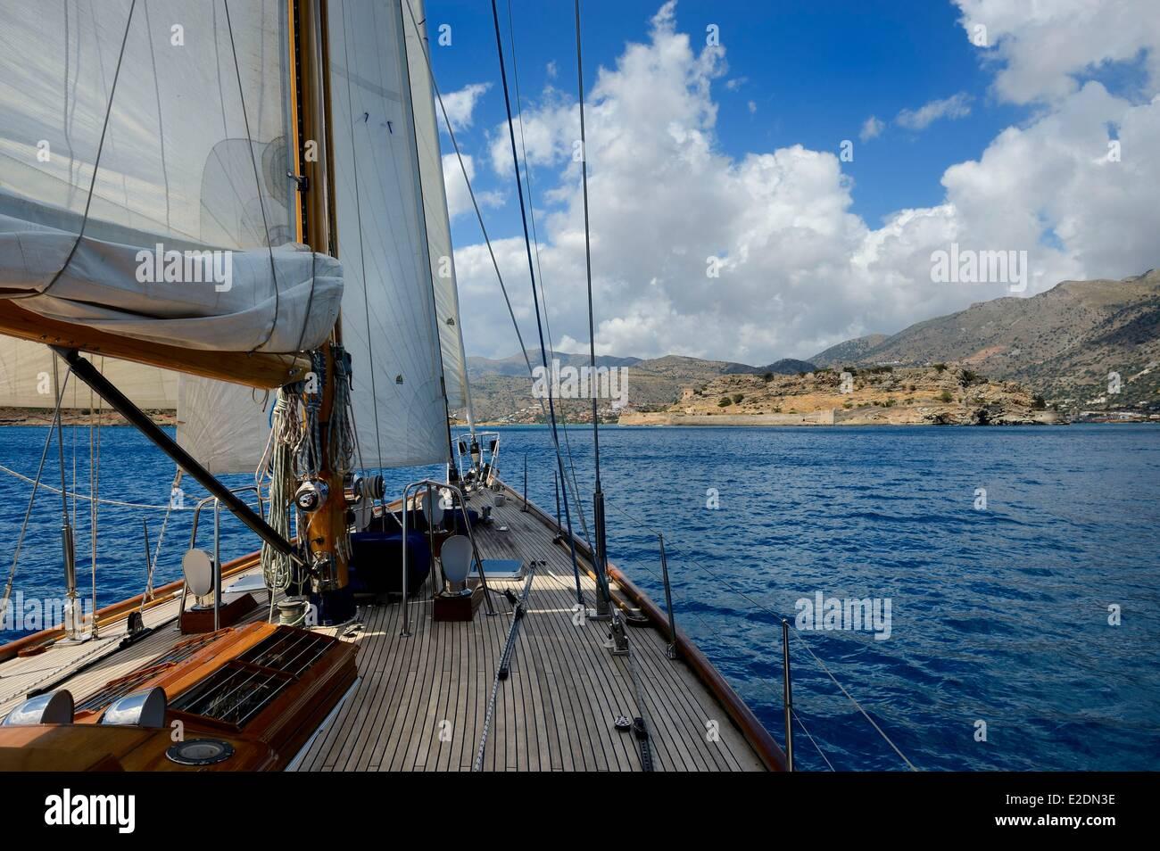 Greece Crete Agios Nikolaos region Elounda 22 meters sailing boat next to island Spinalonga Fort (Kalydon) Venetian - Stock Image