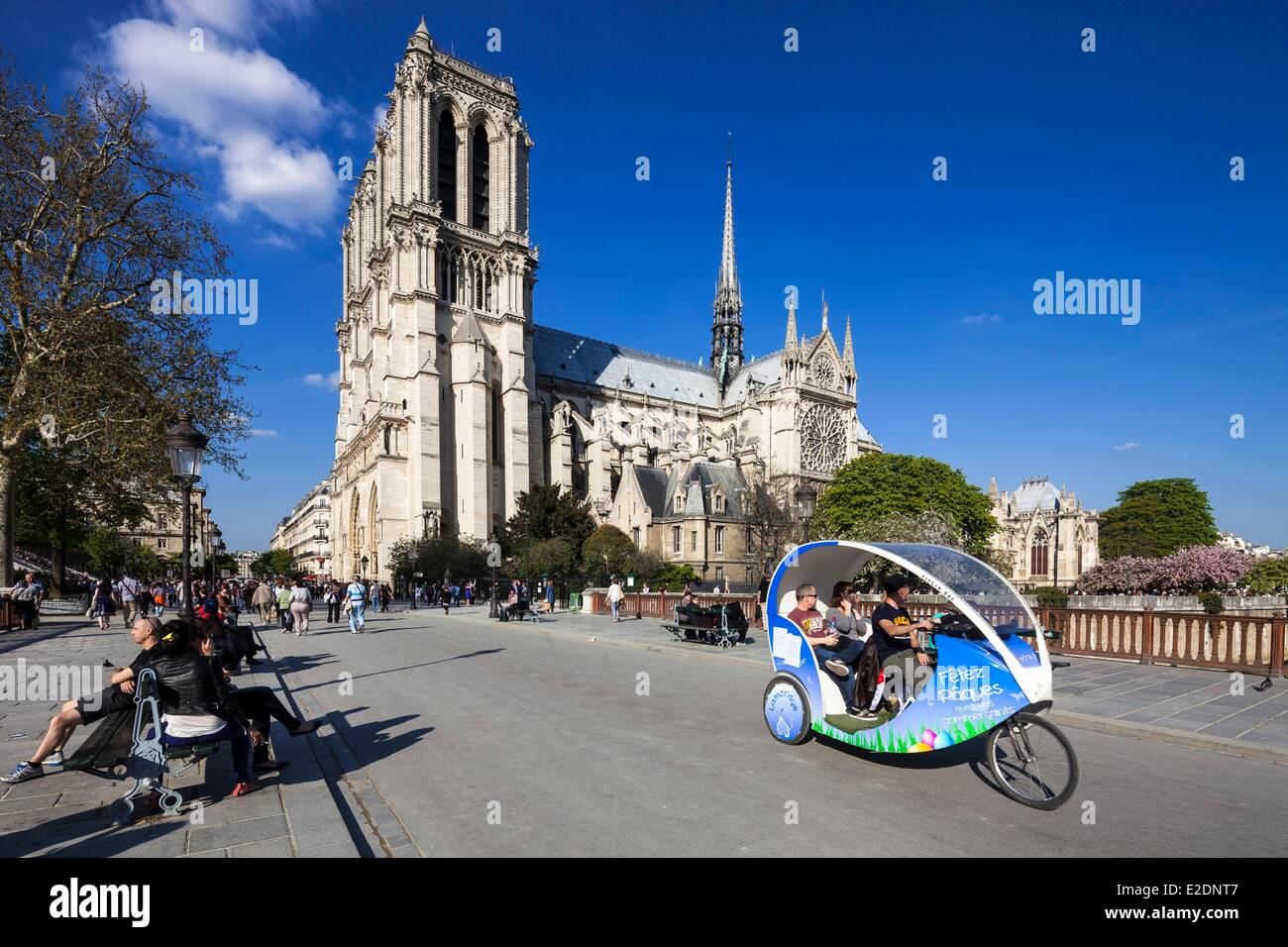 France Paris Notre Dame cathedral and the bridge Double electric bicycle taxi for tourists - Stock Image