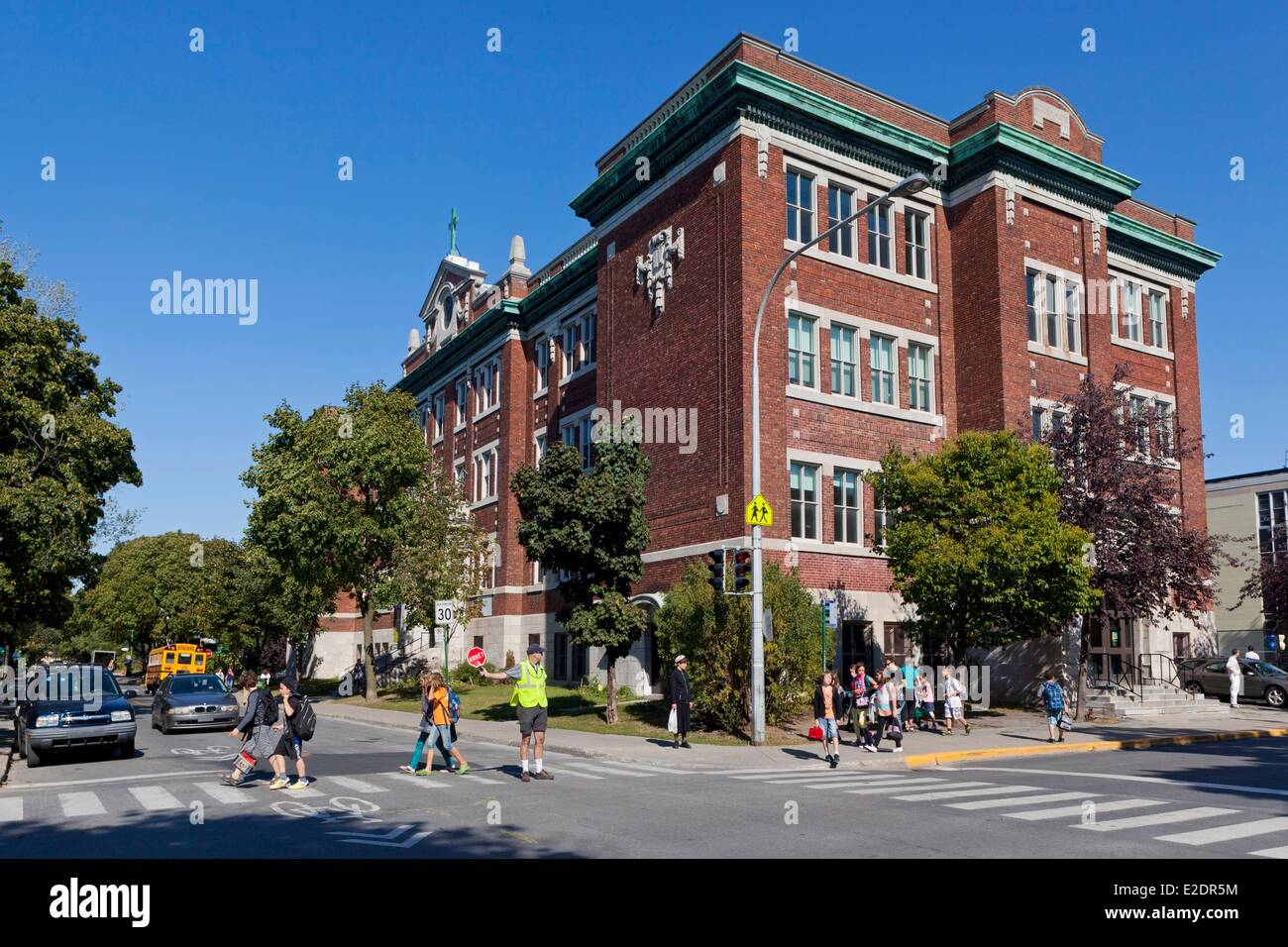 Canada Quebec province Montreal Outremont a primary school children monitored by a scholar crossing guard pedestrian - Stock Image