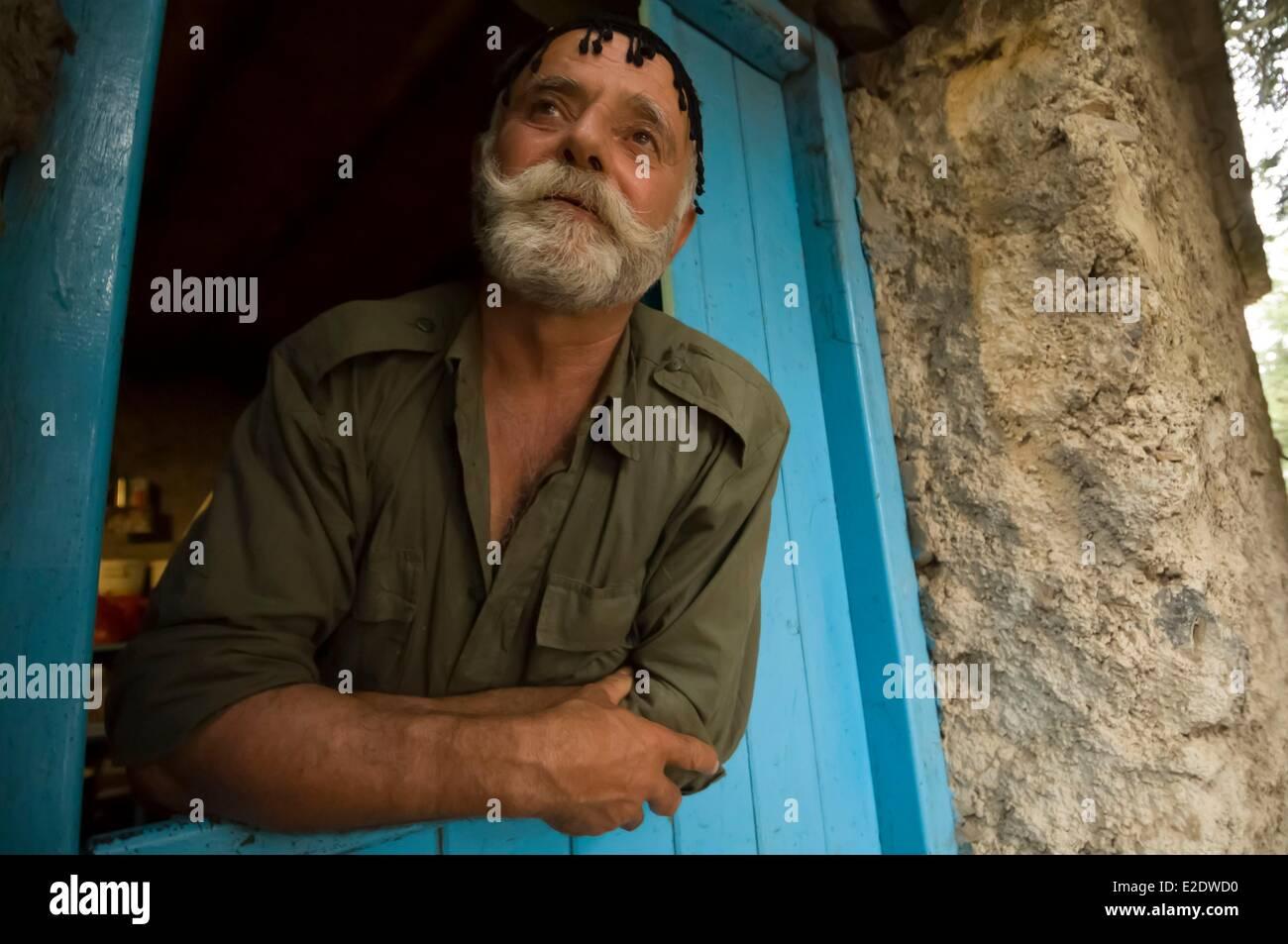 Greece Crete Ortholagos Lefka Ori or White Mountains the shepherd Nikos Votsakis - Stock Image