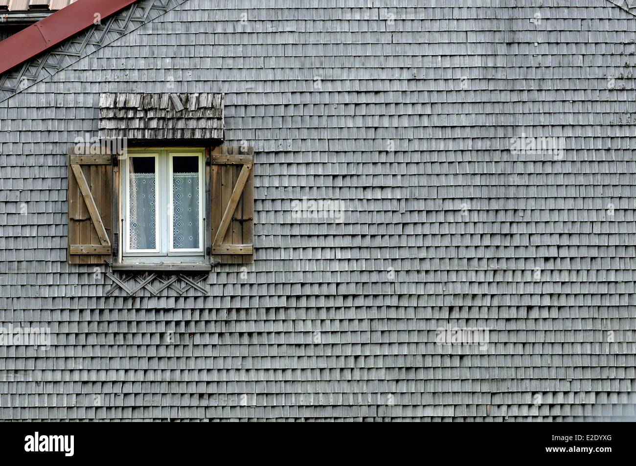 France Jura Lajoux house gable covered with shingles window awning - Stock Image