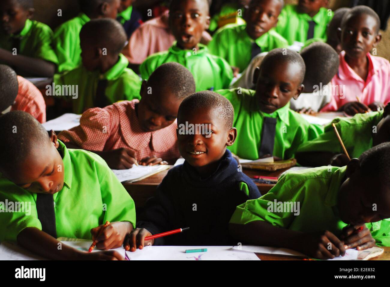 Kenya, Kakamega, black african schoolchildren studying with a smile in classroom - Stock Image