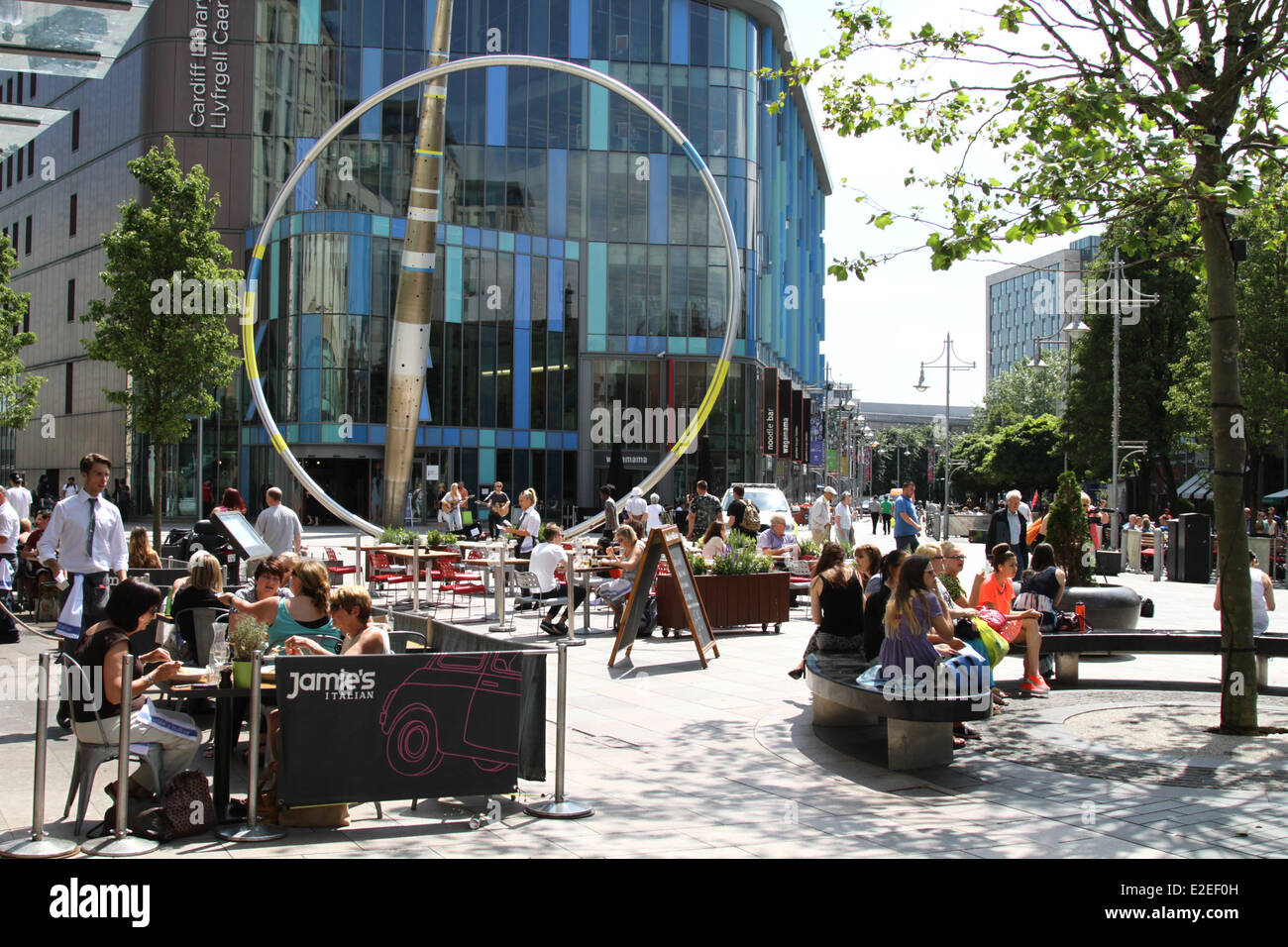 People enjoying the sunshine in Cardiff city centre, during the hot weather in June, South Wales UK. - Stock Image