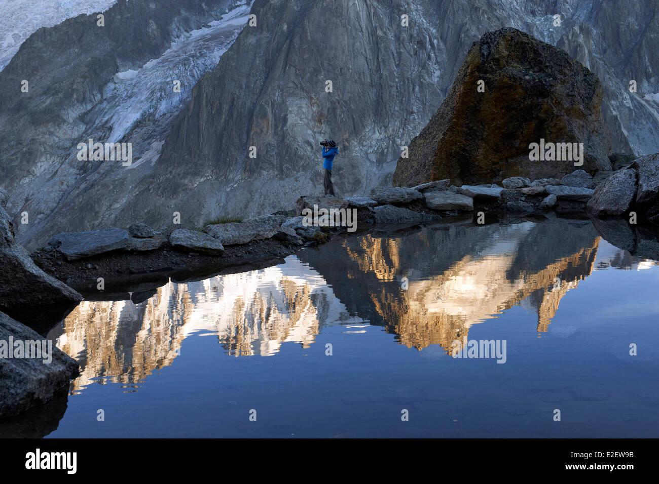 France, Haute Savoie, Chamonix Mont Blanc, reflexion of Dent du Geant (4013m) on refuge du Couvercle - Stock Image