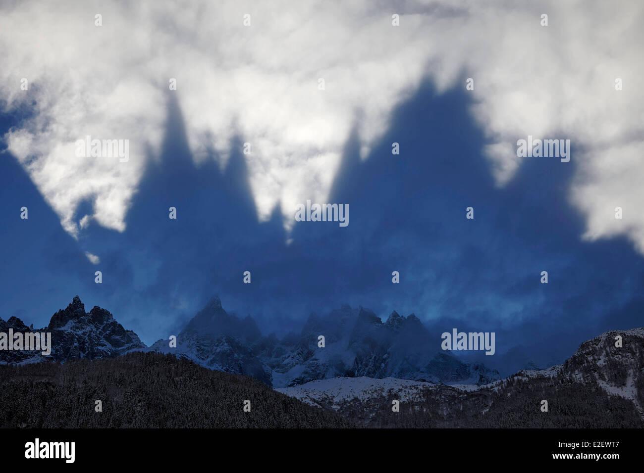 France, Haute Savoie, reflexion of the Aiguilles de Chamonix on the below clouds, Mont Blanc Massif - Stock Image