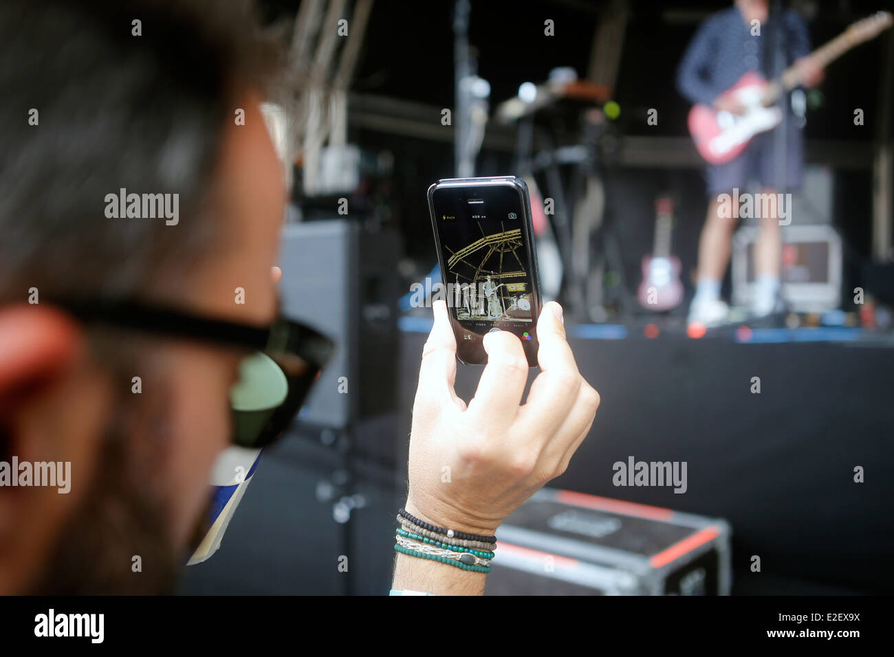 A man pictures with his mobile phone a live event during Sonar advanced music festival in Barcelona, Spain - Stock Image