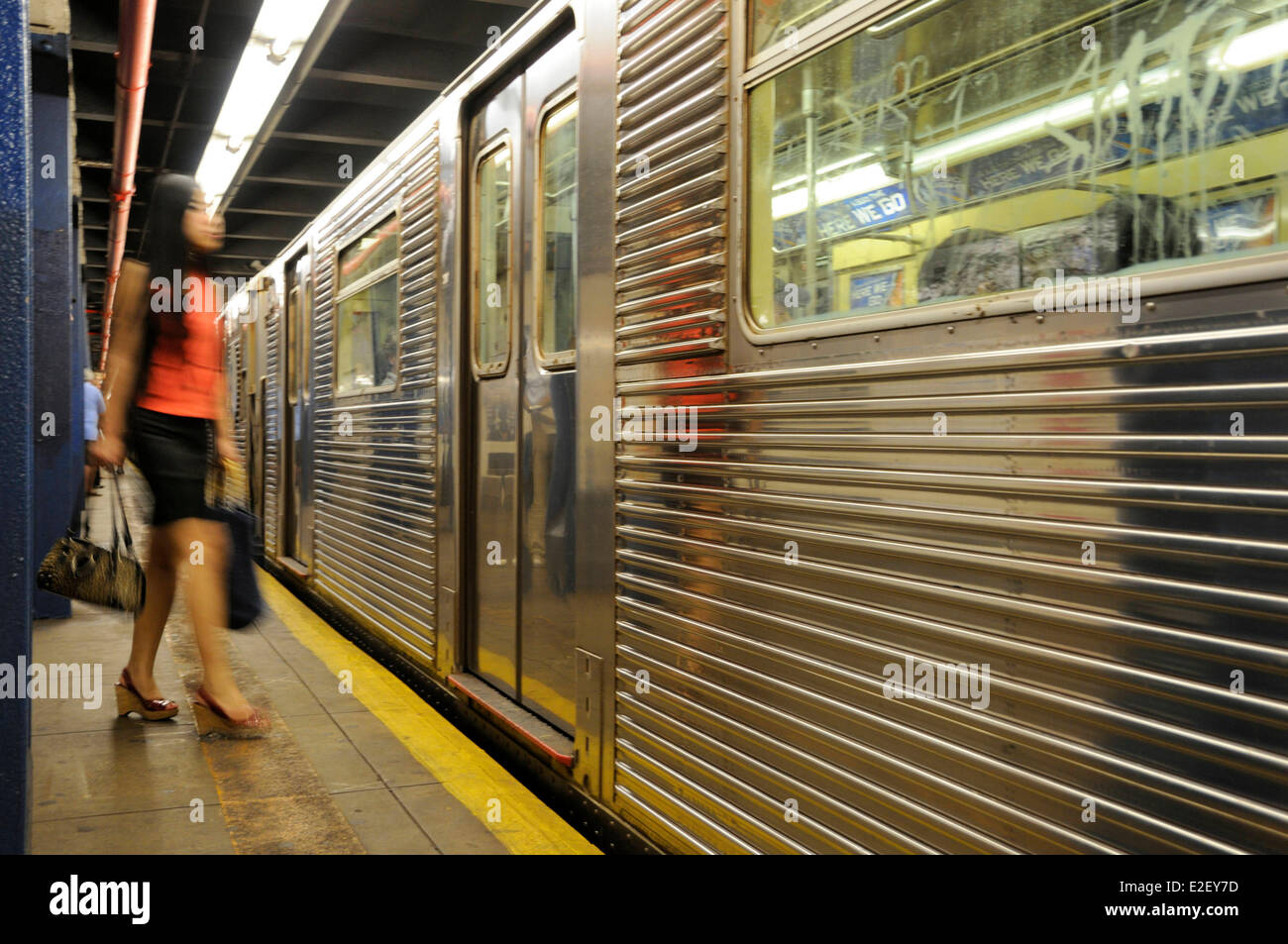 United States, New York, subway station Central Park West, young woman on the platform - Stock Image