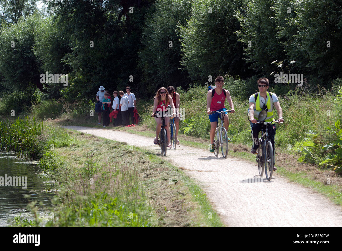 Cambridge May Bumps, cyclists on the River Cam towpath - Stock Image