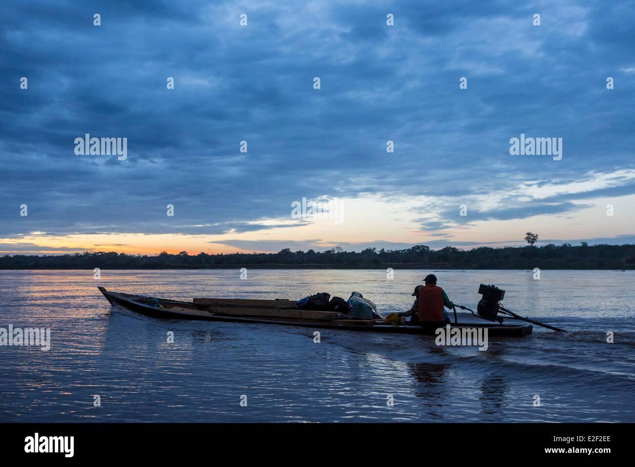 Peru, Madre de Dios, Amazon, Puerto Maldonado, canoe at sunset on the Rio Madre de Dios river - Stock Image