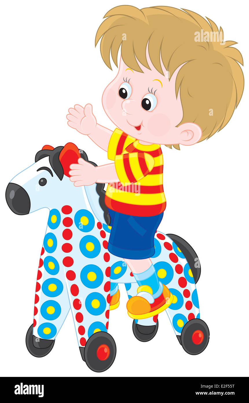 Boy riding on a colorful toy horse - Stock Image