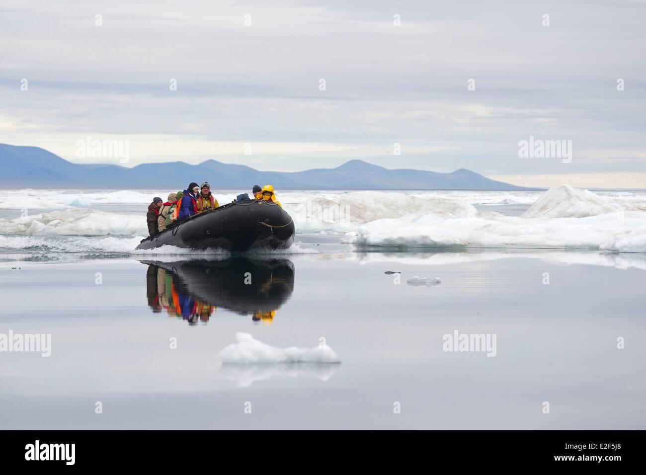 Russia, Chukotka autonomous district, Wrangel island, Pack ice, photographers on board of zodiacs Stock Photo