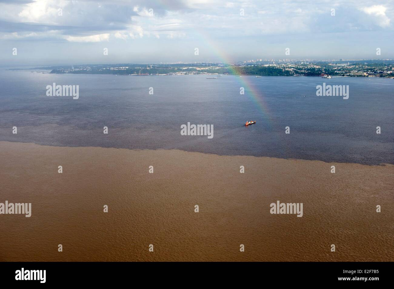 Brazil Amazonas State Amazon River phenomenon of the meeting of waters the black waters of the Rio Negro meet the - Stock Image