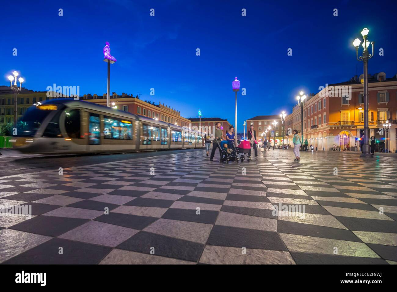 France, Alpes Maritimes, Nice, Place Massena, streetcar and artwork called Conversation a Nice by Jaume Pensa - Stock Image