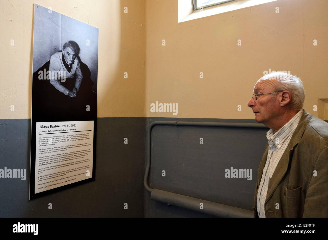 France Rhone Lyon Montluc Prison Memorial a family member of a man dead in deportation observes the portrait of Stock Photo