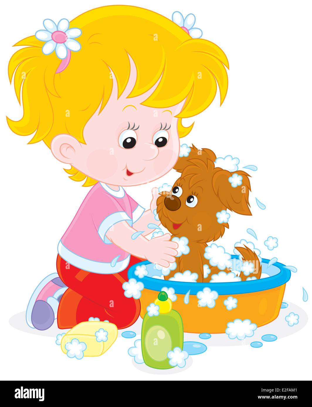 Girl washing a puppy - Stock Image