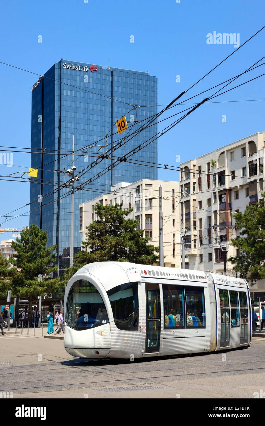 France, Rhone, Lyon, tram in front of the Swiss Life Tower - Stock Image
