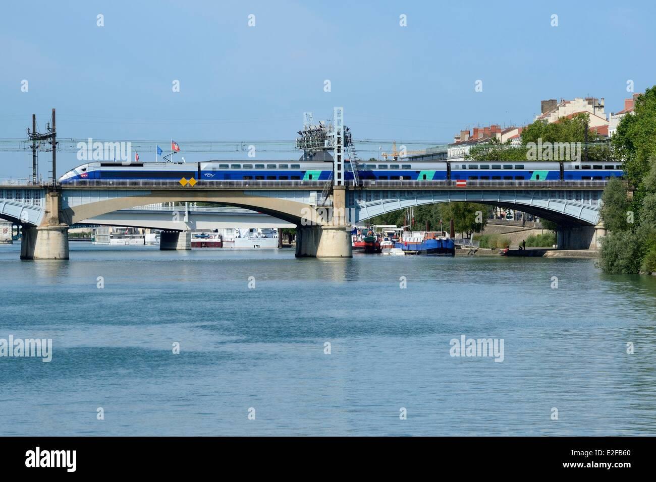 France, Rhone, Lyon, high speed train (TGV) crossing the Rhone near the Perrache station - Stock Image