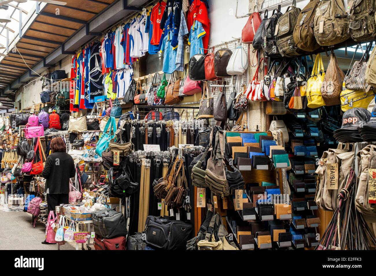 Cyprus, Paphos, indoor market, seller of clothing and fashion accessories - Stock Image