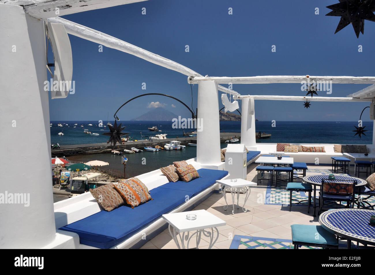 aeolian Islands, Panarea, Lisca Bianca Lounge bar, Stromboli in the background - Stock Image