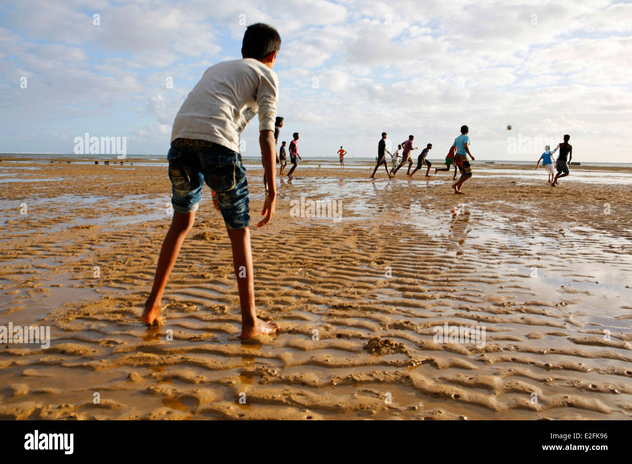 Mauritius, South bank, Bel Ombre village, children playing football the beach - Stock Image