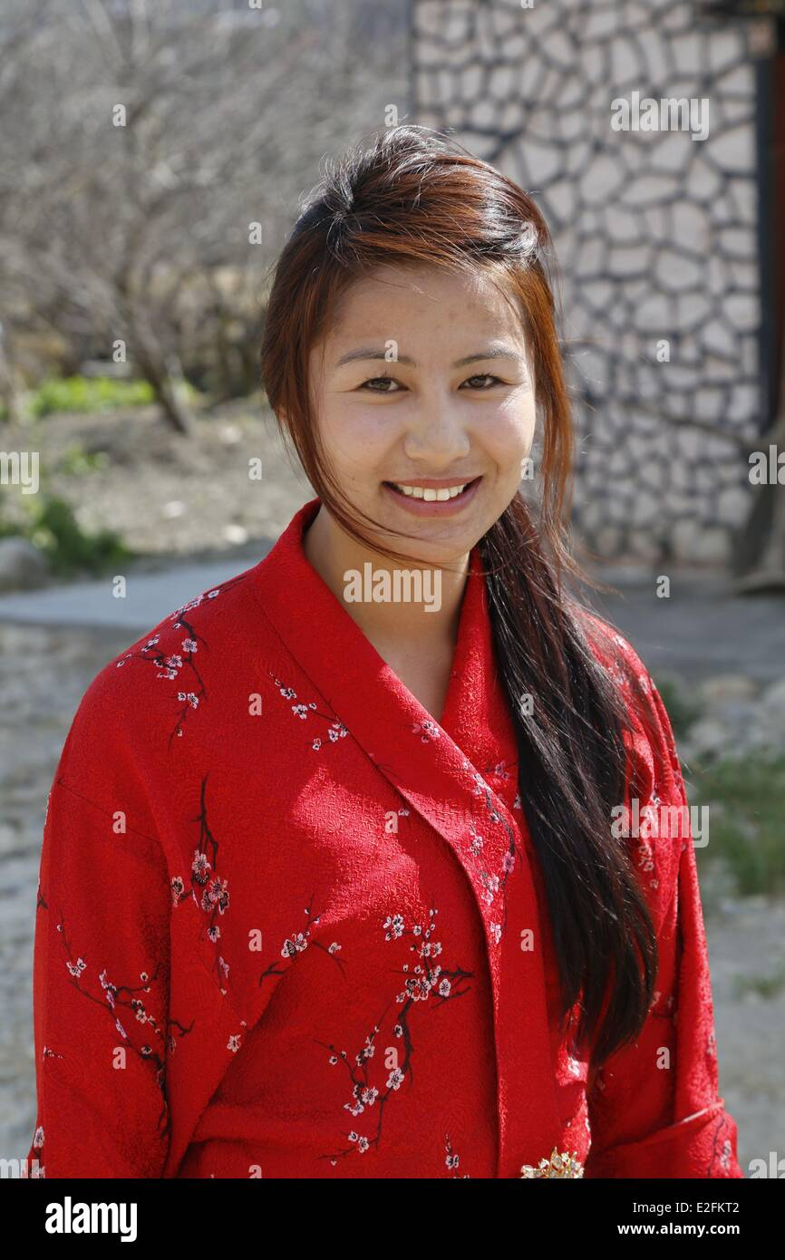 Bhutan district of Paro the road to Taktschang traditional house young lady - Stock Image