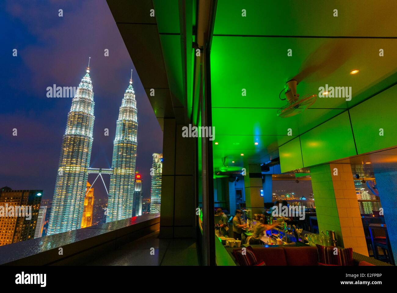 Malaysia Kuala Lumpur view of Petronas Twin Towers designed by the Argentine architect Cesar Pelli from Sky Bar - Stock Image