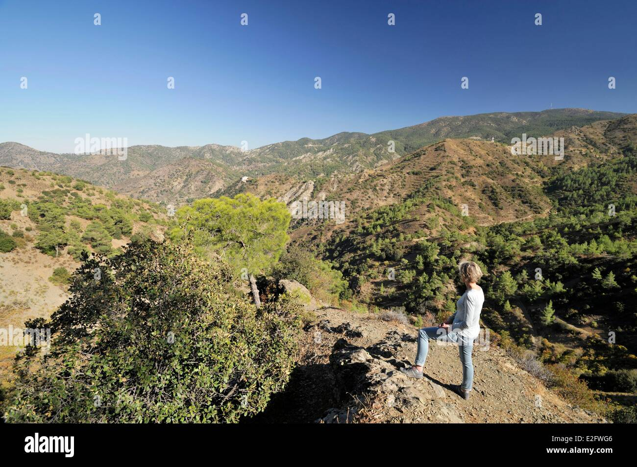 Cyprus Nicosia District Pedoulas woman looking at the forests of Troodos and Mount Olympus - Stock Image
